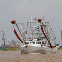 Fishing Boat Rigged with Oil Boom